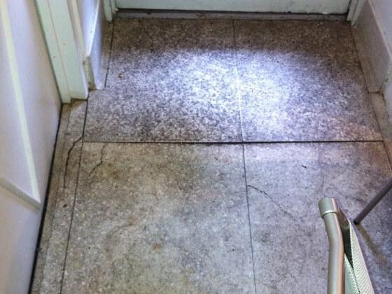Before: natural stone flooring in disrepair